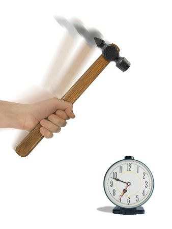 Alarm clock and hammer in hand, isolated on white (clipping path for hand and clock) photo