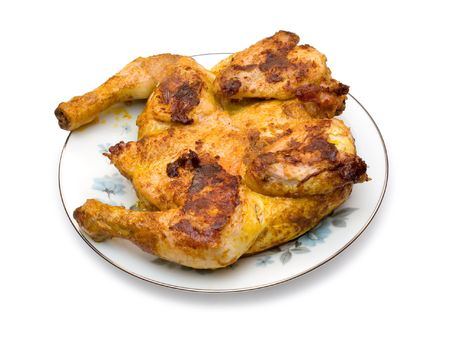 Roasted chicken on plate, isolated on white (clipping path) photo