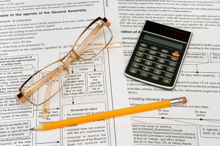 Glasses, pencil and calculator on business background Stock Photo - 769364