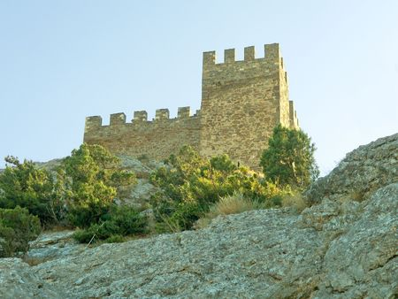 Tower of fortress on the stone photo