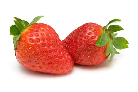 Two strawberries, close-up, isolated on white background photo