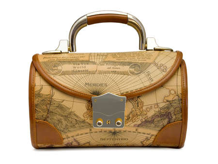 Handbag with retro world map, isolated on white photo