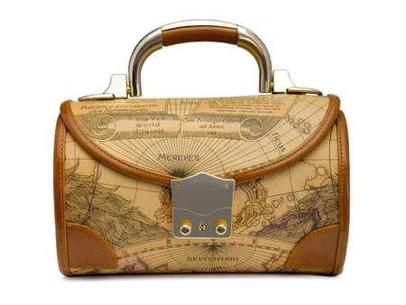 Handbag with retro world map, isolated on white photo