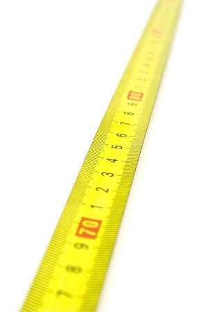 Yellow tape measure, isolated on white background photo