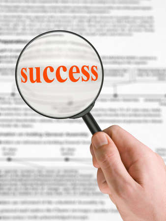 Word Success, magnifying glass in hand, business background photo