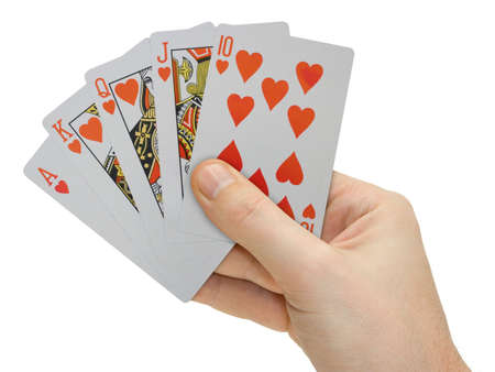 Hand with playing cards, isolated on white