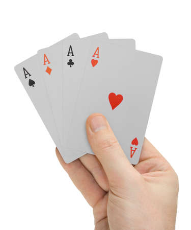 Hand with playing cards (four Aces), isolated on white photo