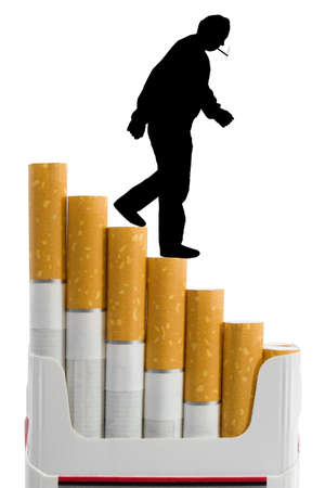 Cigarettes like a staircase and silhouette of smoker, isolated on white photo