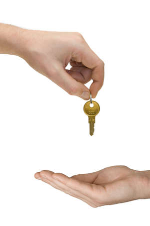 Hands and golden key, isolated on white background photo