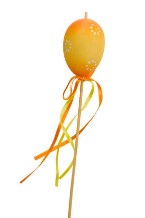 Easter egg on stick, isolated on white photo