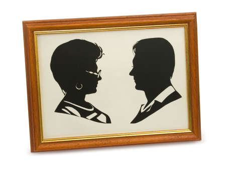 shadowgraph: Silhouette of happy couple in frame, isolated on white Stock Photo