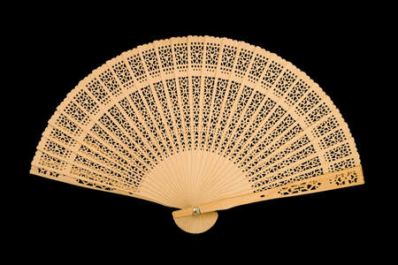 Wooden fan, isolated on black background photo