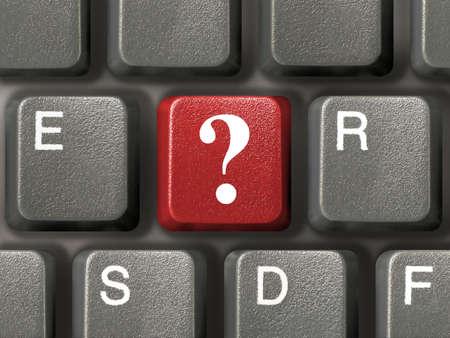 Computer-Tastatur (close-up) mit roten Fragezeichen Schl�ssel