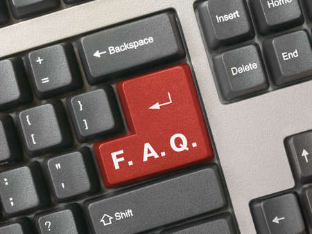 Computer keyboard with red key FAQ, closeup photo