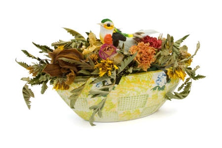 Dried flowers and bird in vase, isolated on white background photo