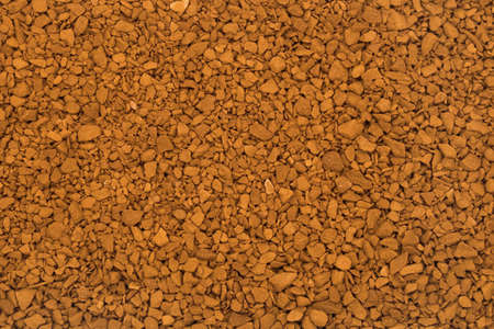 granular: Coffee background, brown granular texture