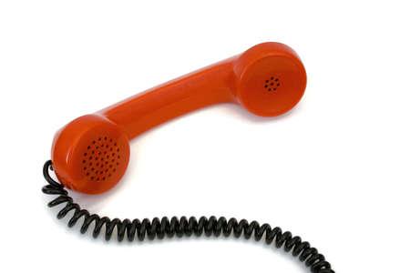 Retro telephone receiver, isolated on white background photo