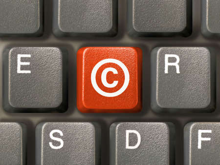 publisher: Keyboard (close-up), red key with Copyright symbol Stock Photo