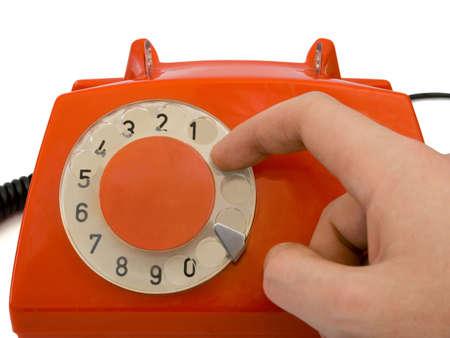 Hand and retro telephone, isolated on white background photo