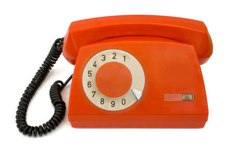 Red retro telephone, isolated on white background photo