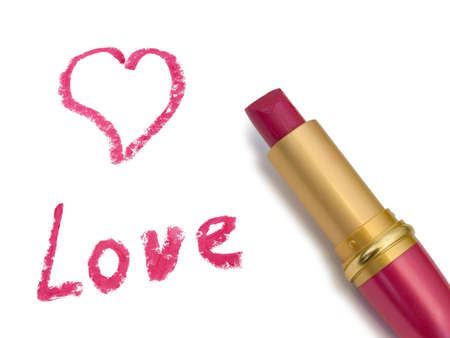 Word Love, heart and lipstick, isolated on white background photo