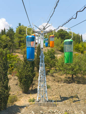 Multicolored cabins of cable railway photo