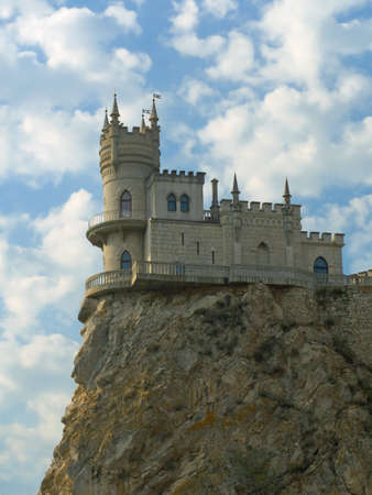 Old castle on cliff, cloudy sky Stock Photo