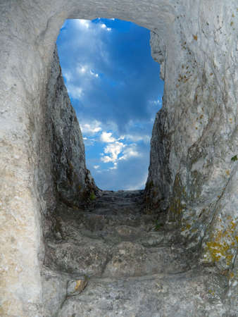 Old stone staircase from cave to sky photo