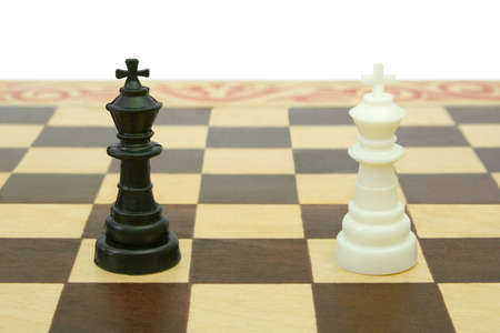 conquering: Two kings on chessboard (tie), isolated on white background