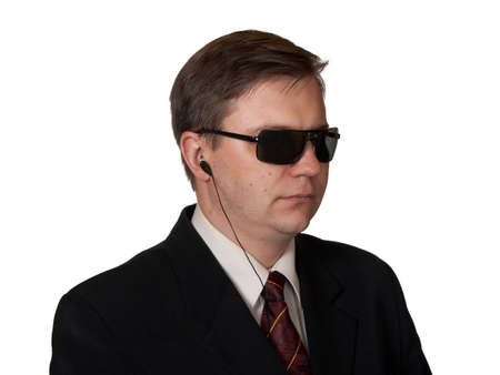 Bodyguard in sunglasses, isolated on white background Stock Photo - 1898598