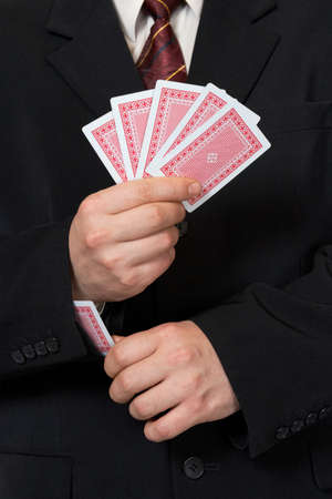 Hands and card in sleeve, poker game