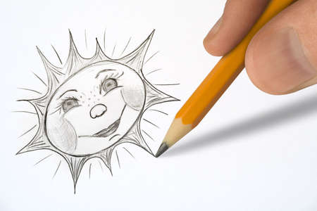 Hand painting smiling sun on white paper photo