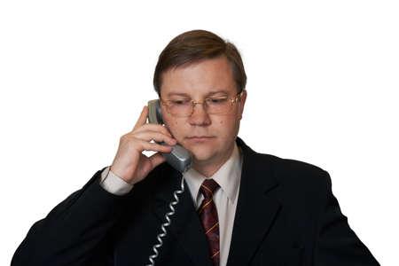 Businessman talking by telephone, isolated on white background Stock Photo - 1954424