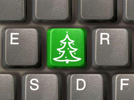 Computer keyboard, key with christmas tree, close-up photo