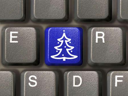 Computer keyboard, key with christmas tree, close-up Stock Photo - 2211475