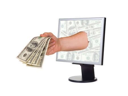 Hand with money and computer monitor, isolated on white background photo