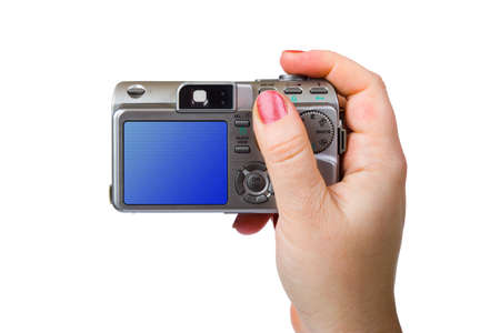 Photo camera in hand, isolated on white background photo