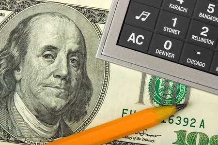 making music: Calculator, money and pencil, business background