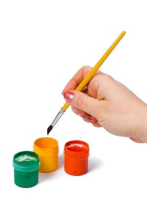 Hand with paintbrush, isolated on white background photo