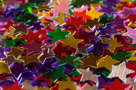 Mulicolored stars, abstract holiday background photo