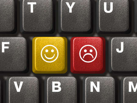 dissatisfaction: Computer keyboard close-up with two smiley keys (emoticons) Stock Photo