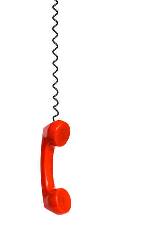 Telephone receiver and cord, isolated on white background photo
