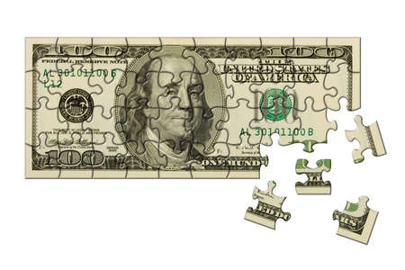 Banknote 100 dollars puzzle, isolated on white background photo