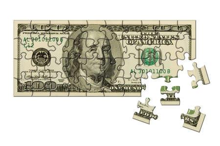 Banknote 100 dollars puzzle, isolated on white background photo