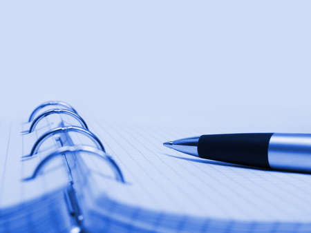 Macro of pen and notebook, business background Stock Photo