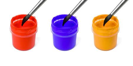 Paintbrushes and paints, isolated on white background photo
