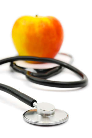 Medical stethoscope and apple, isolated on white background Stock Photo - 2548717