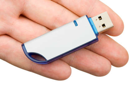 Flash drive in hand, isolated on white background photo