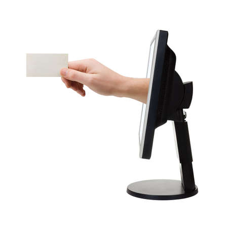 Computer screen and hand with card, isolated on white background photo