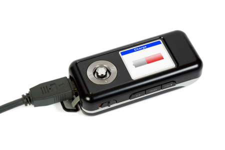 Charging mp3 player, isolated on white background photo